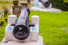 Old black cannon at the public outdoor museum. The cannon was invented in China as early as the 12th century and traces its develo. Pment from the fire lance Royalty Free Stock Image