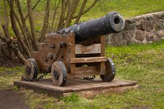 The old cast-iron cannon on a wooden stand stock photography