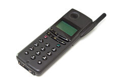 Old black cell phone. Isolated on the white background Royalty Free Stock Image