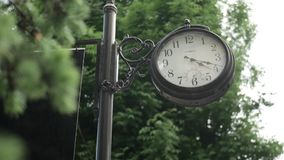 Old black clock in the sity stock video footage