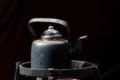 Old black coffee pot. Outdoors Stock Image