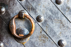 Old black door with ring knocker Royalty Free Stock Photo