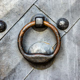 Old black door with ring knocker Royalty Free Stock Images