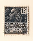 An old black french postage stamp with an illustration of a stylized african woman commemorating a colonial exhibition in 1931. Leeds, England - May 02 2018: An Royalty Free Stock Image