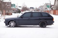 Old, black, German family car side view in winter Royalty Free Stock Images