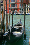 Old Black Gondola. Gondola in the small canals of the romantic Venice Royalty Free Stock Images