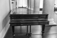 Old black grand piano closeup, black and white Stock Photo