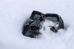 Black skull mask covered with snow royalty free stock photo