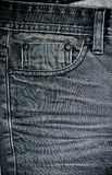 Old black jeans close-up. Pocket. Stock Photo