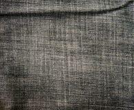 Old black jeans torn denim texture vintage Stock Photo