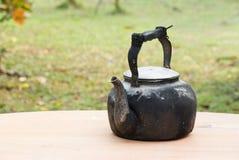 Old black kettle Stock Image