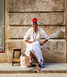 Old black lady dressed in typical cuban clothes Royalty Free Stock Photo