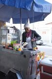 Old black lady hot dog seller