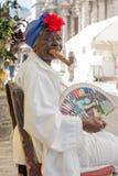 Old black lady smoking a cuban cigar in Havana Royalty Free Stock Photos