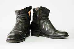 Old black leather boots Stock Photos