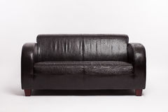 Old black leather couch Royalty Free Stock Image