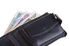 Old black leather wallet. With some money in it Royalty Free Stock Image