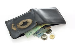 Old black leather wallet with money isolated. Royalty Free Stock Photography
