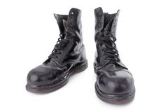 Old black leather work boots Royalty Free Stock Photos