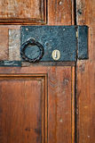 Old black lock with round handle on door Stock Photography