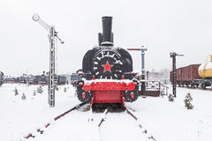 Old black locomotive with large red star Stock Image