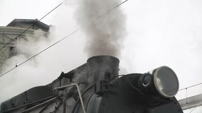 Old black locomotive. steam smoking in real time. stock video footage