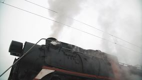 Old black locomotive. steam smoking in real time. stock footage