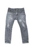 Old black male jeans isolated on white Stock Photography