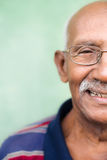 Old black man with glasses and mustache smiling Stock Image