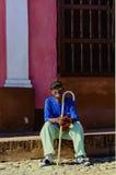 Old black man resting on steet of Havana, Cuba Royalty Free Stock Photos