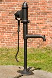Old black mechanical water pump Stock Images