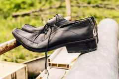 Old black men shoes. Like symbol of time and past Stock Image