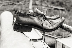Old black men shoes. Like symbol of time and past at black and white Royalty Free Stock Photography