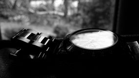 Old black metal chronograph watch Stock Photos