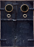 Old black metal door Royalty Free Stock Photos