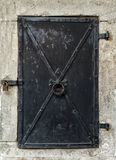 Old black metal door. Stock Photos