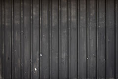 Old black metal sheet, steel texture, steel wall in the dark. Abstract background stock photo