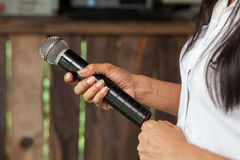 Old black microphone in hand. Stock Photography
