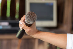 Old black microphone in hand, depth of field Stock Images