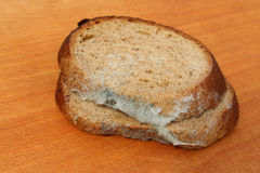 The old black mold on the bread. Spoiled food Stock Photo