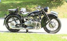 Old black motorbike Royalty Free Stock Photography