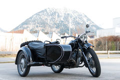 Old black oldtimer motorcycle with sidecar Royalty Free Stock Images