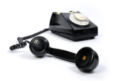 Old black phone. With focus on the handset in the foreground Royalty Free Stock Photography