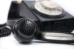 Old black phone. With focus on the handset in the foreground Stock Photo