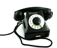 Old black phone. View of an old black telephone on the white background Stock Photos