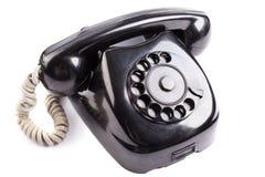 Old black phone. On white background Stock Photography