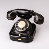 Old black phone with dust and scratches on white background Royalty Free Stock Photo