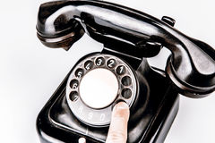Old black phone with dust and scratches on white background. Old black phone with dust and scratches, isolated on white background - retro Stock Photos