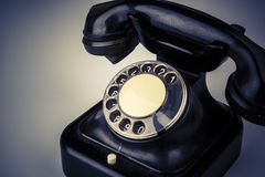 Old black phone with dust and scratches on white background Royalty Free Stock Photography
