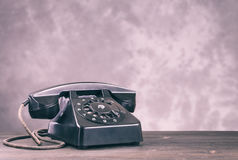 Old black phone on light Royalty Free Stock Photography